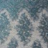 TULLE GEBORDUURD WATER GREEN