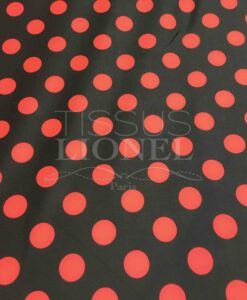 Lycra printed red dots on a black background
