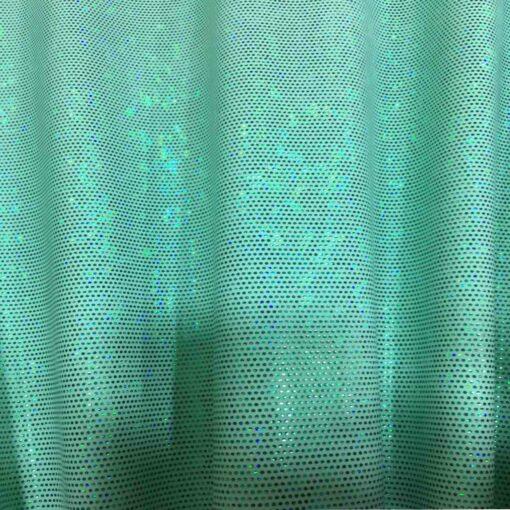 Lycra pailleté fond vert pâle pailleté vert hologramme