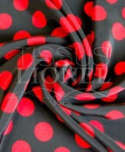 polyester imprimé fond noir gros pois rouge