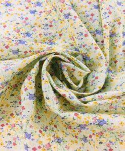 Tissu coton fleuris flammé