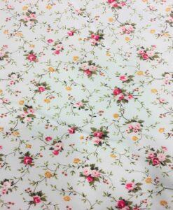 Tissu coton imprimé fleuris petite rose sur fond blanc