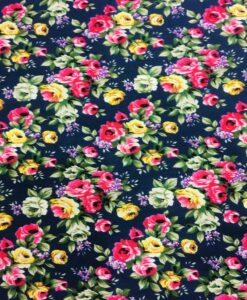 Tissu coton imprimé fleuris rose sur fond marine