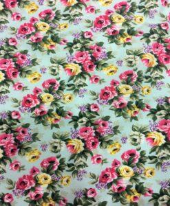 Tissu coton imprimé fleuris rose sur fond turquoise clair