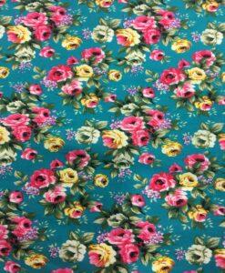 Tissu coton imprimé fleuris rose sur fond turquoise foncé