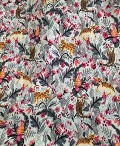 Tessuto di cotone motivo giungla celeste