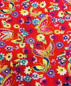Tissu coton imprimé papillon sur fond rouge
