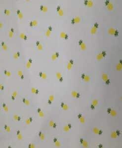 Tela de algodón amarillo con piña milleraies