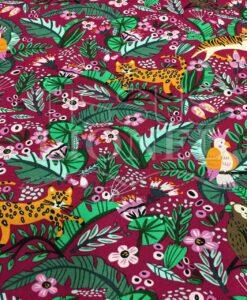 Tissu coton motif chat jungle fond bordeaux