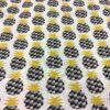 Tissu coton motif imprimé ananas noir et or