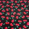 Tissu coton noir motif imprimé cerise