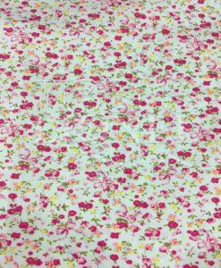 Tissu coton vert pâle motif imprimé fleurs