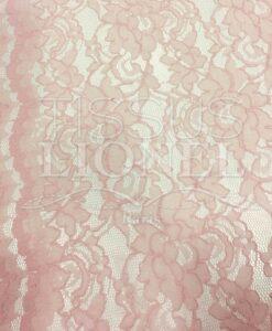 Tissu dentelle couture festonnée rose pâle