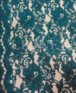 Tissu dentelle couture festonnée vert canard