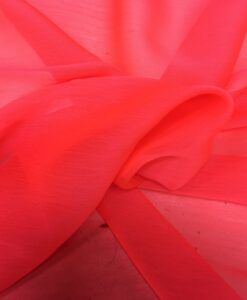Light neon coral muslin fabric
