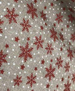 Tela navideña de arpillera roja con copos de nieve